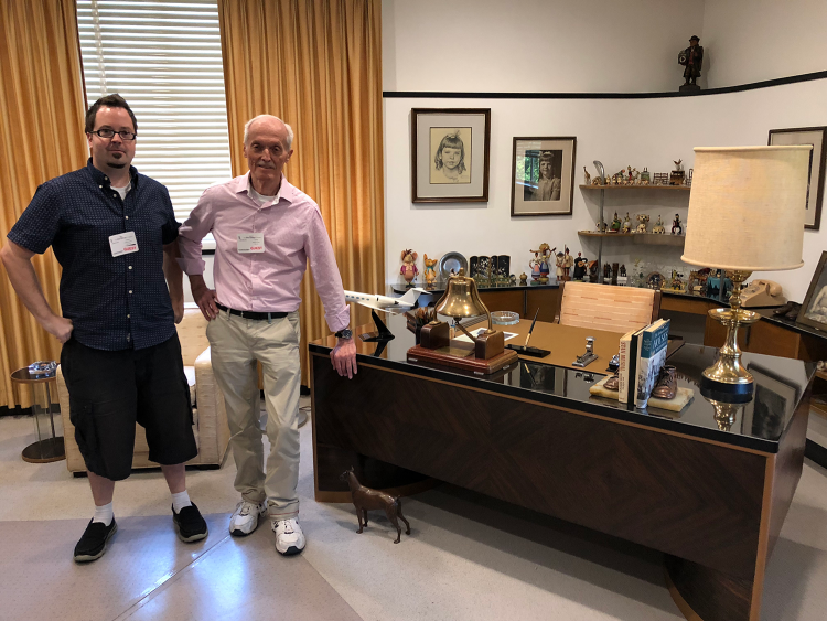 Don Bluth & Lavalle Lee in front of Walt Disney's Desk